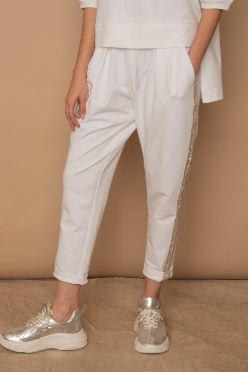 Cotton jogger with appliqué sequin embroidery on one side, woman